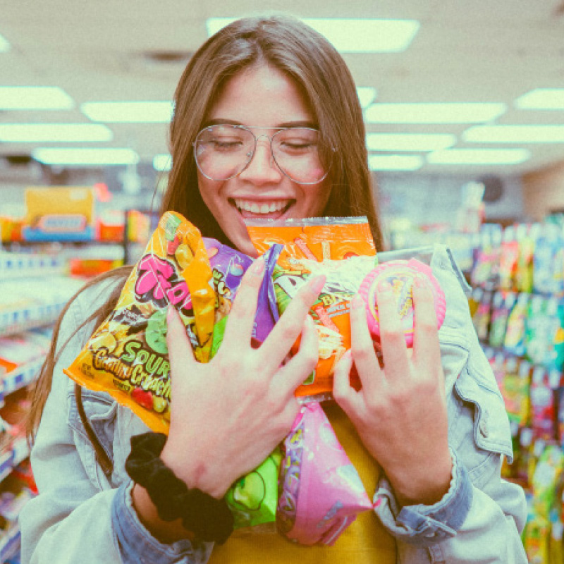 girl candy supermarket smiling glasses happy